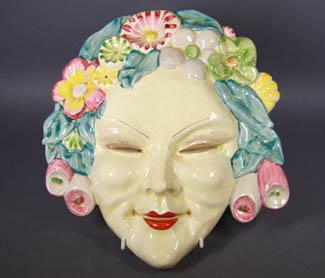 The quaint Clarice Cliff mask, which features in Philips Auctions latest decorative arts sale, first came to public prominence in the Melbourne Herald of November 28, 1935, when it was mentioned in an article about Dr and Mrs Cecil Raphael's new home high on the hill in Glenferrie Road, Glenferrie. As well as the mask there are several other interesting items in the sale on Sunday March 29 at 47 Glenferrie Road, Malvern.