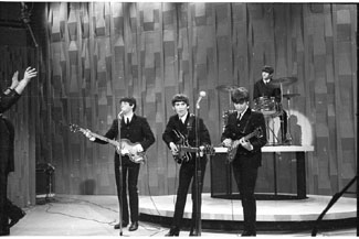 Unique black and white photos taken in 1964 of the Beatles appearing the Ed Sullivan Show, on their way by train to a Washington performance and arriving in Adelaide are among an unusual collection of entertainment memorabilia auction from noon Thursday May 7.
