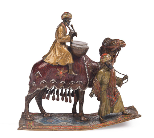 Of particular note at Mossgreen Quarterly Collectors Auction Series is an Austrian (Franz Bergman manner) cold painted bronze of a camel led by an attendant and ridden by a Bedouin playing drums.