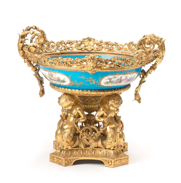 "A grand Sevres porcelain and gilt bronze centrepiece is a major highlight of the Peterson Collection, formed over a lifetime by the late husband and wife team Burton ""Pete"" and Melda Peterson and housed in their Brisbane family home. Mossgreen has been asked to auction the collection in two sessions on Sunday June 18 at the Brisbane City Hall."